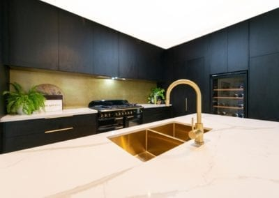 Bold concept with high class finish kitchen gold sink and tap on a big kitchen island in Bowral