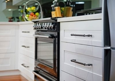 Classic black and white Hamptons kitchen with cooktop cabinetry Narellan Vale