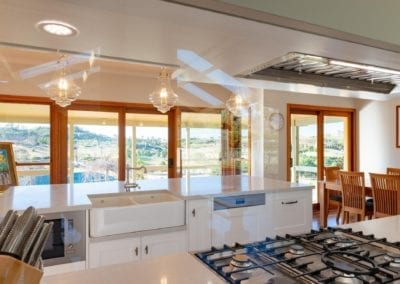 Classic mirrored Hamptons Douglas Park kitchen cook top view to balcony