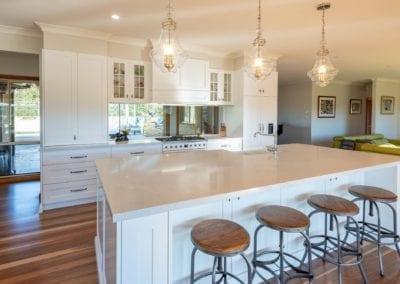 Classic mirrored Hamptons Douglas Park wide shot with kitchen island