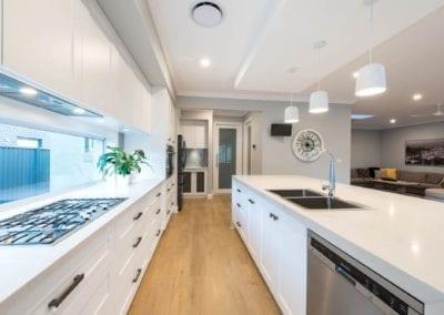 Contemporary Hamptons twist kitchen cooktop run wide view Harrington Grove
