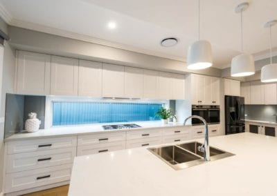 Contemporary Hamptons twist kitchen island with sink and tap Harrington Grove