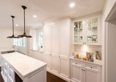 Hamptons kitchen glamour Woollahra custom cabinetry display cabinets with glass windows and pendant lights