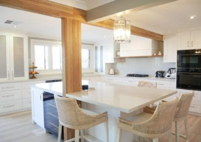 Contemporary Hamptons with timber highlights Barden Ridge with wooden bean, white cabinetry and stone benchtop wide shot