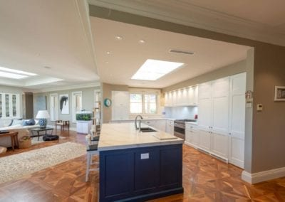 Divine two toned Hamptons kitchen island cabinetry wide shot Mittagong