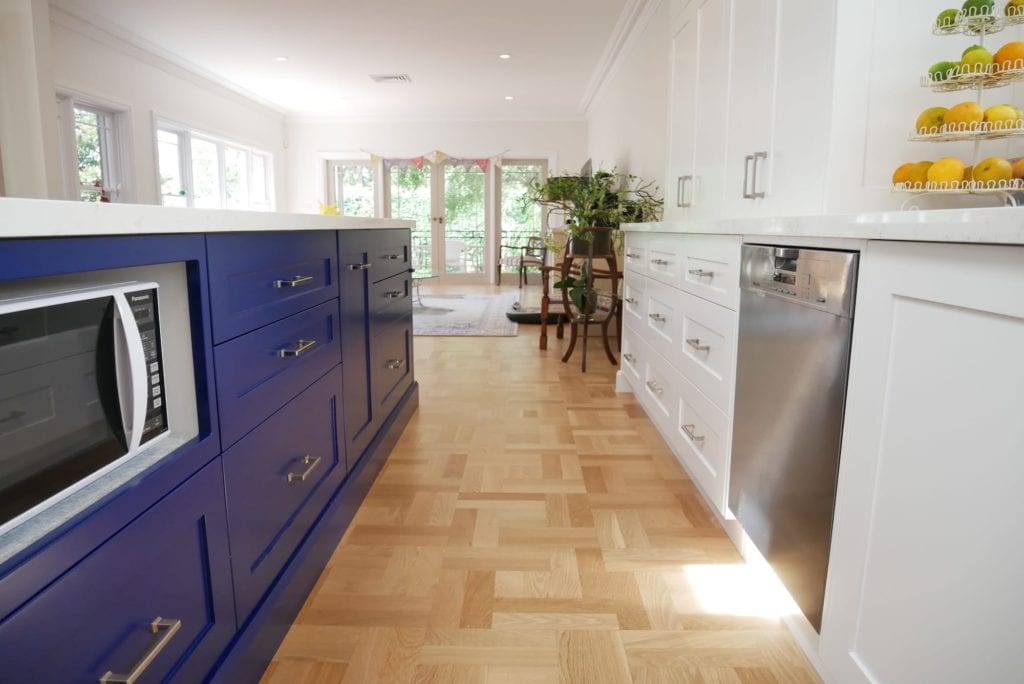 Dramatic two tone kitchen Blakehurst where the microwave sits comfortably amongst the blue hues of the island