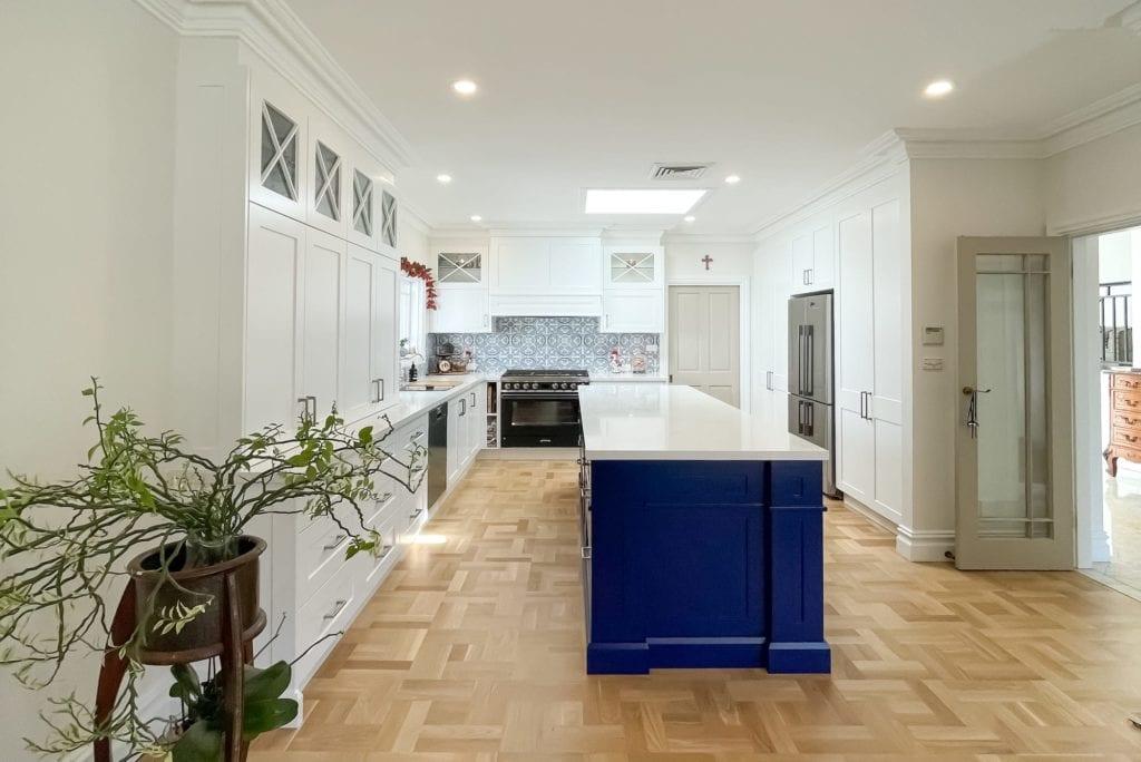 Dramatic two tone kitchen Blakehurst using Dulux Lexicon Quarter strength and Blue Lobelia atop stunning parquetry flooring
