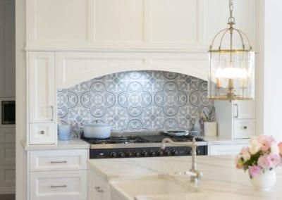 Light antique luxury kitchen Kirkham decorative curved mantle over cooktop
