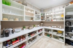 Butler's pantry with lots of open shelving and large open-face drawers