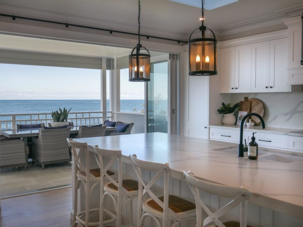 Ocean glamour kitchen Wombarra where the kitchen design flows perfectly onto the covered balcony allowing for easy entertaining