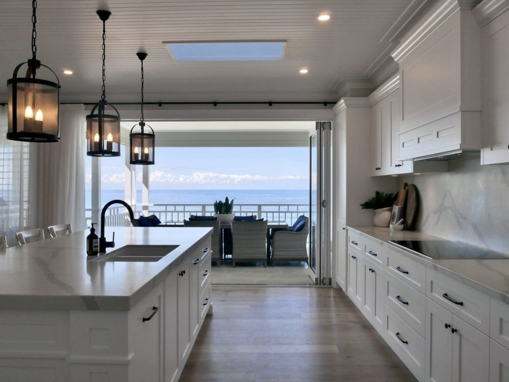Ocean glamour kitchen Wombarra uses Dulux Vivid White in a matt finish for a simple yet glamorous tone that perfectly compliments the stunning view.