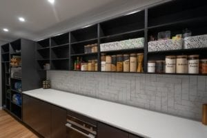 Large Butler's pantry with lots of open shelving and bench space