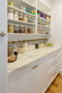 Butler's pantry with well-organised open shelving and under bench cabinetry