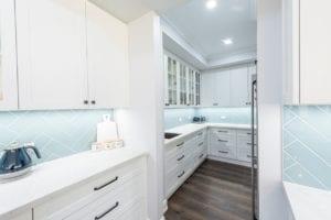 Hamptons style Butler's kitchen with blue herringbone splashback