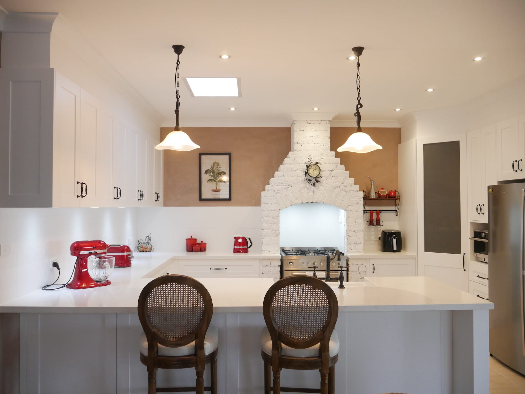 Character country filled kitchen in Mittagong white cabinetry with overhanging lights