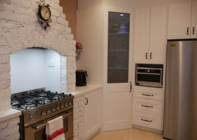 Character country filled kitchen in Mittagong with pantry and white brick