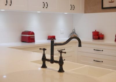Character country filled kitchen in Mittagong brass tapwear