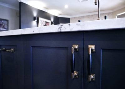 Dramatic two tones kitchen Bowral with brass handles and white marble stone