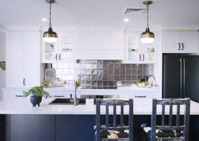 Dramatic two tones kitchen Bowral with two handing light pendants over the kitchen island