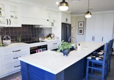 Dramatic two tones kitchen Bowral with metallic splashback