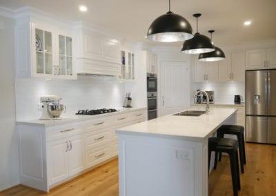 Elegant black and white Hamptons kitchen cooktop run East Bowral