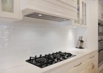 Elegant black and white Hamptons kitchen rangehood East Bowral