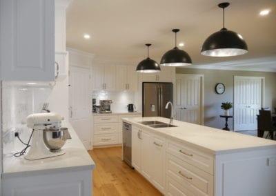Elegant black and white Hamptons kitchen sinktop run East Bowral