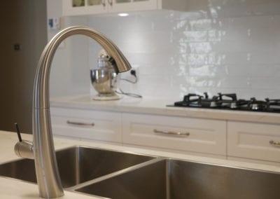 Elegant black and white Hamptons kitchen tap East Bowral