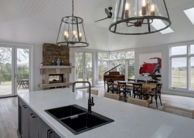 Stylish country hamptons style kitchen in moss vale dining area and fire place with black tapwear