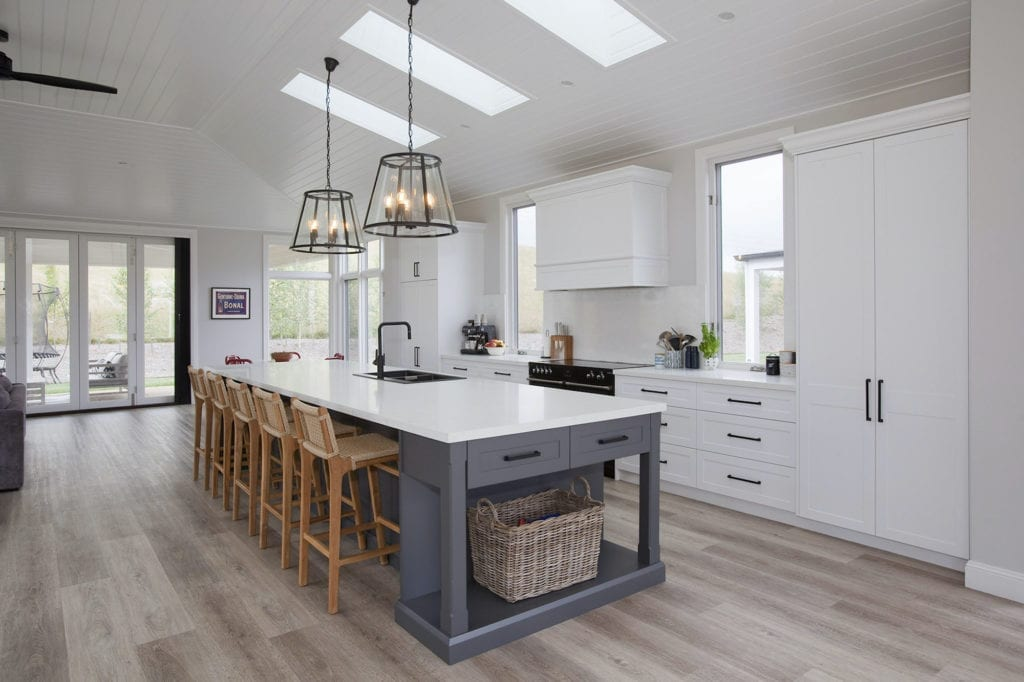 Stylish country hamptons style kitchen in moss vale white cabinetry and large kitchen island