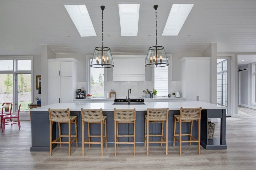 Stylish country hamptons style kitchen in moss vale large kitchen island handing pendant lights and wicken chairs